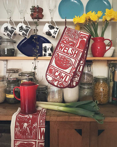 Welsh Cawl Gift Set Tea Towel Apron and Oven gloves wrapped in tissue presented in a gift box