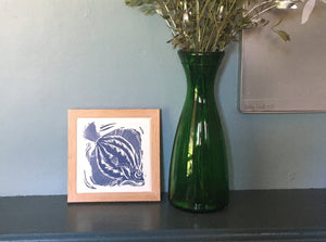 Plaice handmade framed tile trivet lino cut by Kate Guy in dark blue