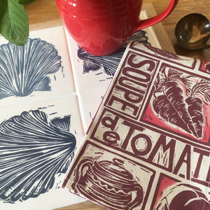 Tomato soup illustrated recipe napkin with scallop lino cut trivet by Kate Guy
