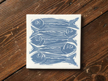 Load image into Gallery viewer, Sardines lino cut handmade tile trivet by Kate Guy