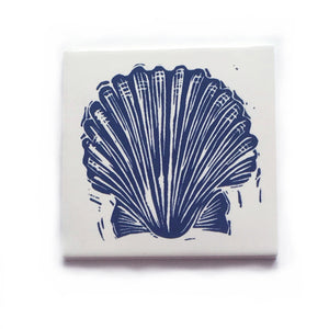 Scallop shell handmade tile in dark blue on cream, lino cut print by Kate Guy