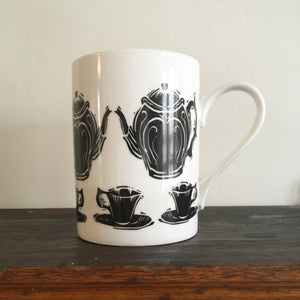 Porcelain mug decorated with lino cut tea pot and cup by Kate Guy