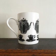 Load image into Gallery viewer, Porcelain mug decorated with lino cut tea pot and cup by Kate Guy
