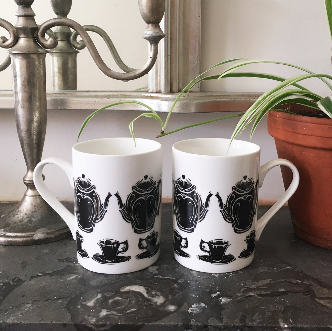 Porcelain mugs decorated with lino cut tea pot and cup by Kate Guy