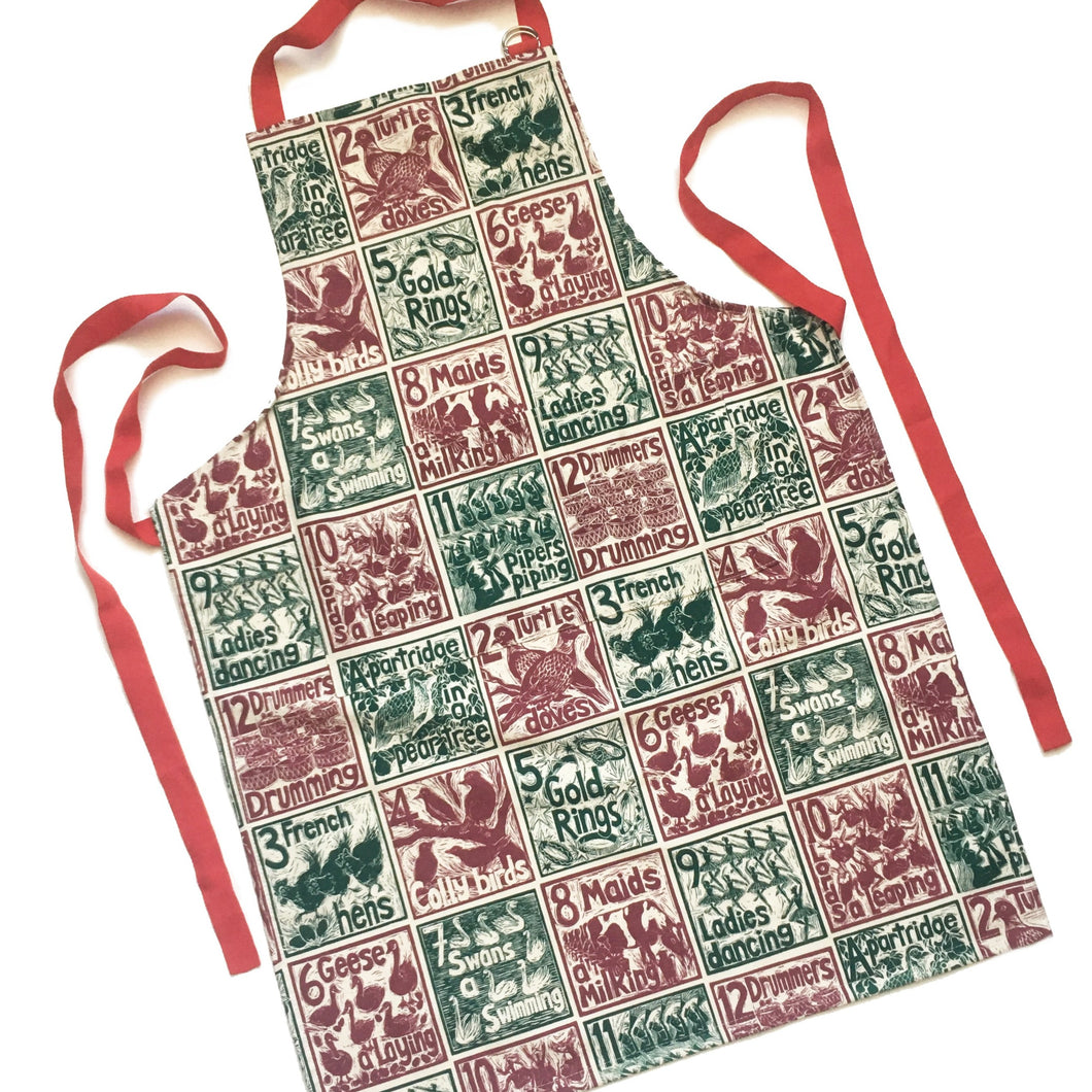 The Twelve days of Christmas organic cotton apron lino cut by Kate Guy
