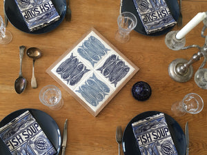 Sardines tiles Handmade trivet, table centrepiece. Linocut print of 5 fish on four tiles framed in English oak