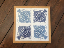 Load image into Gallery viewer, Plaice Handmade tile trivet, table centrepiece. Linocut print of fish on four tiles framed in English oak.