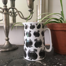 Load image into Gallery viewer, Onion gravy jug and decorated with black and white lino cut prints of onions by Kate Guy