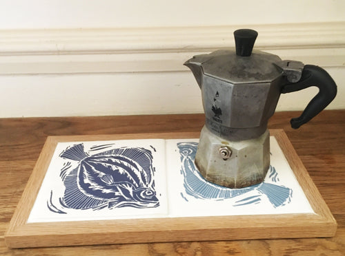 Plaice handmade ceramic double tile framed trivet; Prussian Blue and Pale Smoke Blue, screen printed with lino cut by Kate Guy