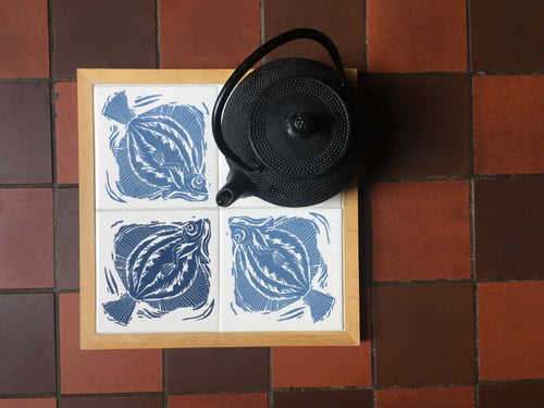 Plaice Handmade tile trivet, table centrepiece. Linocut print of fish on four tiles framed in English oak.
