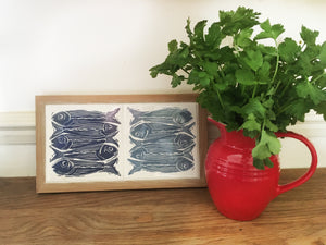 Sardines tile trivets in oak frames lino cut by Kate Guy in dark and pale blue