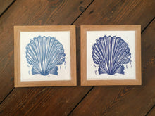 Load image into Gallery viewer, Scallop Shell Handmade tile trivet, table centrepiece. Linocut print of scallop shells on four tiles framed in English oak