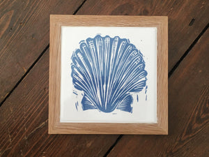 Scallop shell framed tile trivet in pale blue lino cut print by Kate Guy