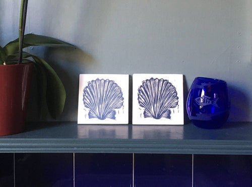 Scallop shell tile trivets in pale and Prussian blue lino cut print by Kate Guy