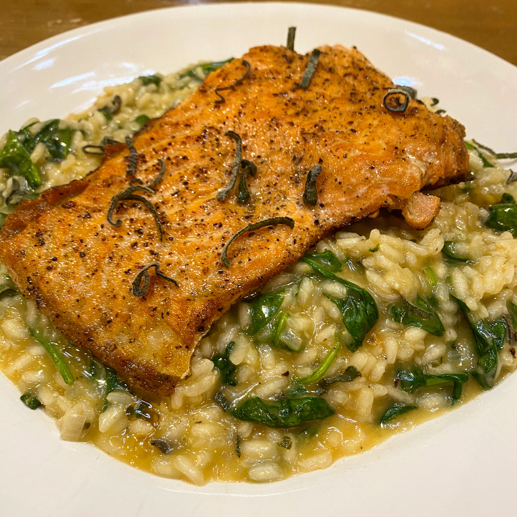 creamy spinach risotto with bruschetta butter and steelhead trout