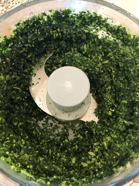 kale in food processor with churn pesto butter
