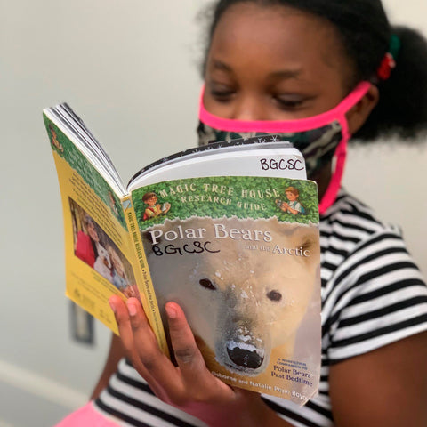 A young child reads a book