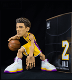 Lonzo Ball collectible figurine in a Los Angeles Lakers yellow jersey.