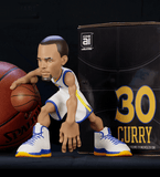 Stephen Curry collectible figurine in a Golden State Warriors white jersey.