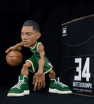 Giannis Antetokounmpo collectible figurine in a Milwaukee Bucks jersey.