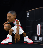 Damian Lillard collectible figurine in a white Portland Trailblazers jersey.
