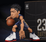 Anthony Davis collectible figurine in a navy New Orleans Pelicans Jersey next to box.
