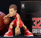 Blake Griffin collectible figurine in a red Los Angeles Clippers Jersey next to box.