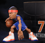 Carmelo Anthony collectible figurine in a blue New York Knicks Jersey next to box.