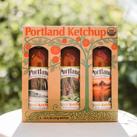 Portland Organic Ketchup 3-Bottle Gift Pack sitting on a table outside, no GMOs, Gluten Free, Dairy Free