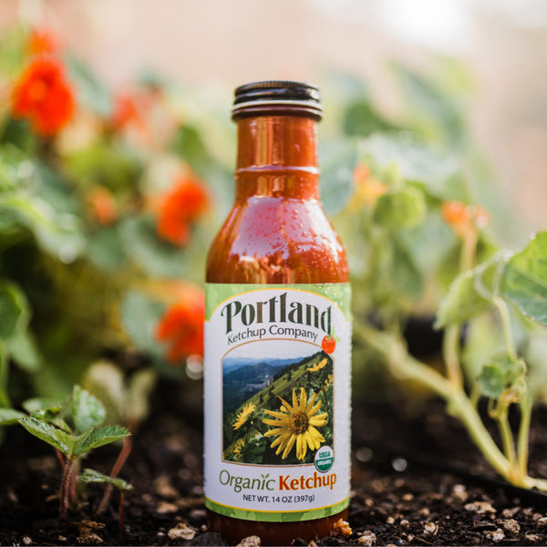 Bottle of Portland Organic Ketchup sitting in a natural setting