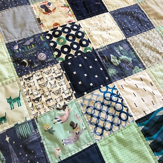 A patchwork quilt I made with my cute daughter for her wonderful teacher. Quilt by Maker Valley / Holly Lesue. Fabric from Zippyboro's Neverland line.