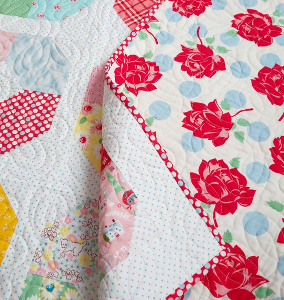 Layer Cake Lucy quilt pattern by A Bright Corner | Scrappy quilt kit by Maker Valley