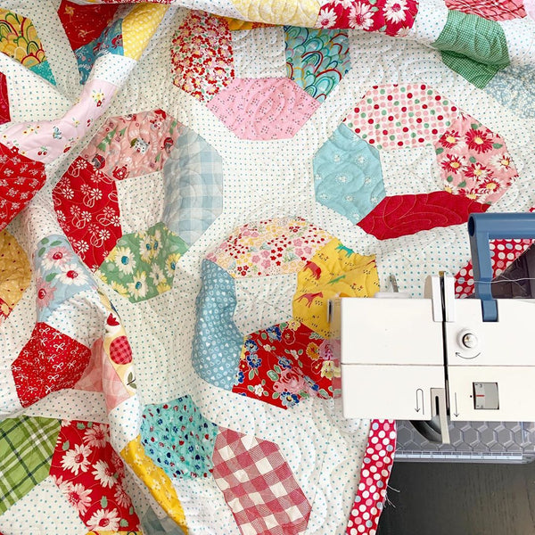 Layer Cake Lucy quilt pattern by A Bright Corner | Quilt by Maker Valley