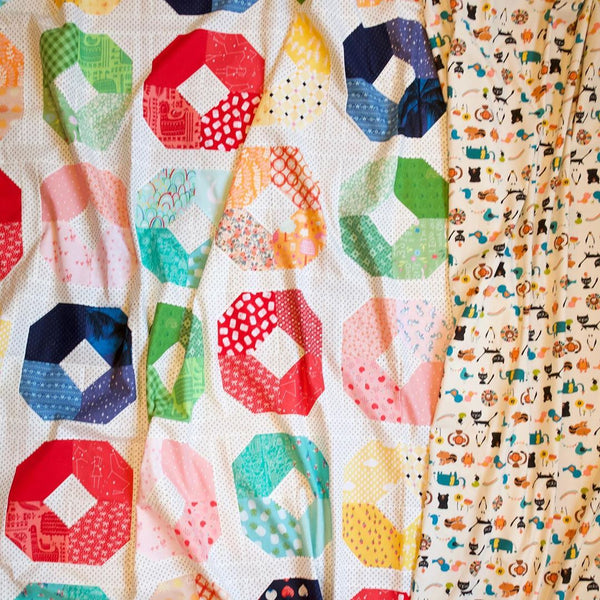 Layer Cake Lucy quilt patter by A Bright Corner | Quilt kit by Maker Valley