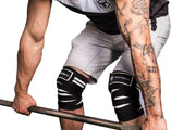 black-white knee wraps protects during deadlift