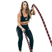 all woman using battle rope for cardio