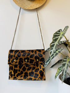 Leopard print leather cross body bag and clutch