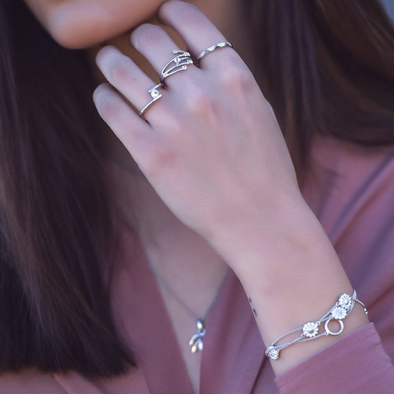 Christina Jewelry & Watch lifestyle image 2019 _Thrown Ring_Mountain Ring_SuperNova Ring__Forest Necklace & Pendant_Marguerite Field Bracelet.
