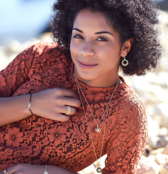 Christina Jewelry & Watches 2019_2020 Lifestyle images featuring the Circles of Happiness Earrings, Cocktail Ring, and stacking with the Wisdom & Black Marguerite Necklaces, all hand crafted in Sterling Silver with 18ct Gold Vermeil with Genuine hand set Gemstone