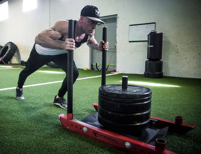 How to Use Power Sled Training for Strongman