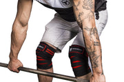 black-red knee wraps protects during deadlift