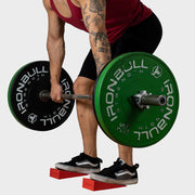 Weight lifter using silicon squat wedges for a better deadlift form