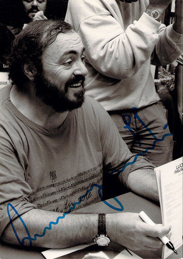 Luciano Pavarotti signed photo shown signing autographs