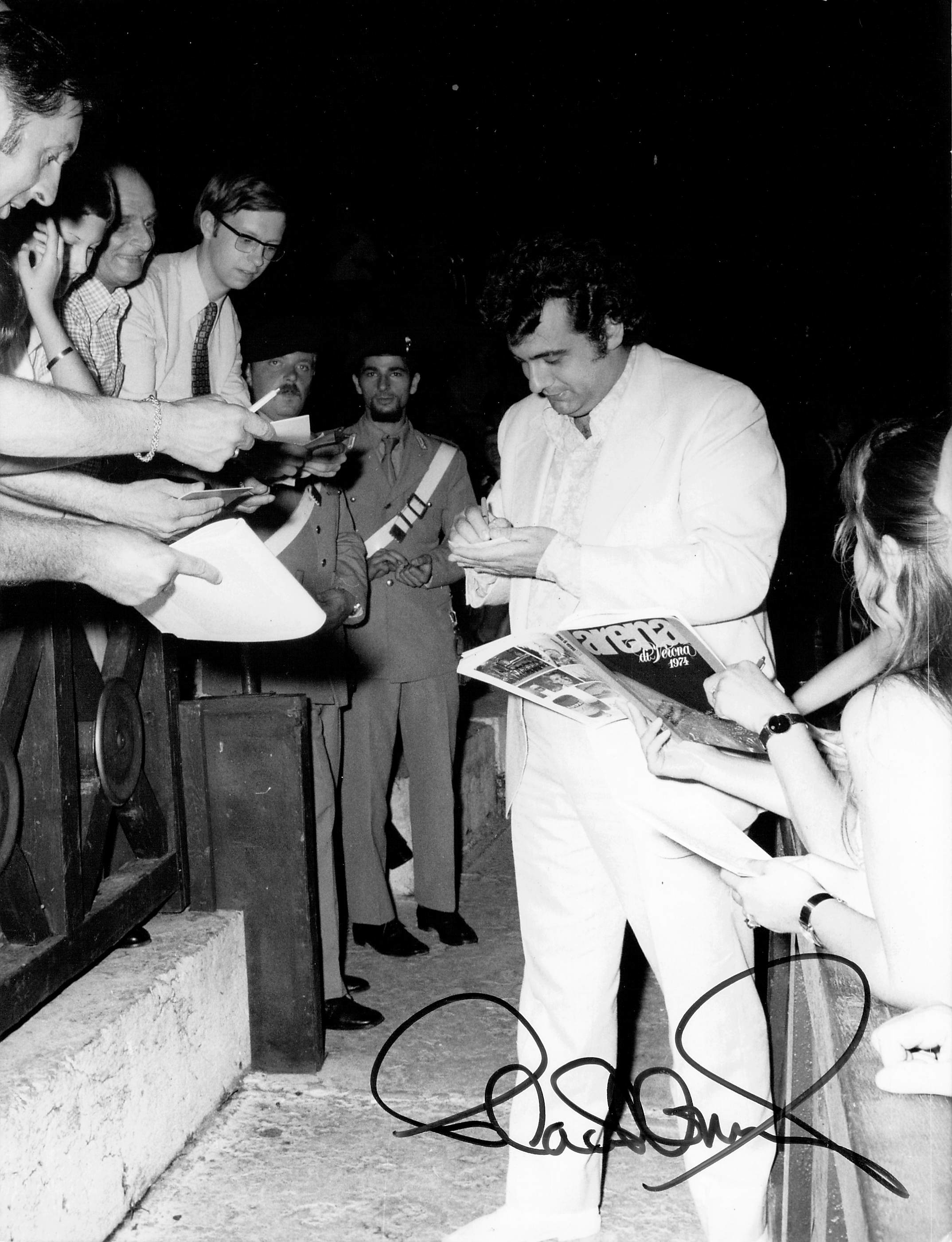 Placido Domingo signing autographs
