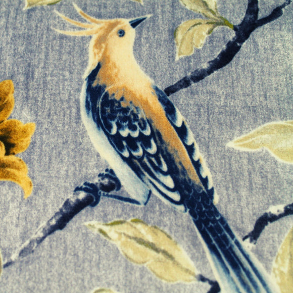 bird print upholstery fabric in muted tones of greige and blue grey.