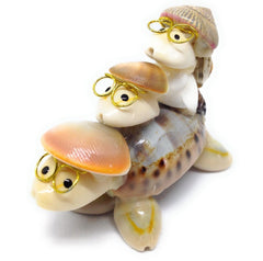 Famille de tortues en coquillages