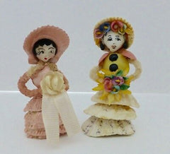 2 Personnages fille avec coquillage