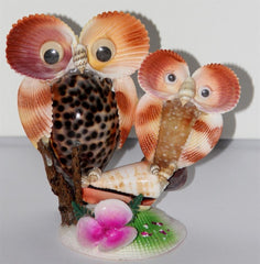 statues hibou en coquillages