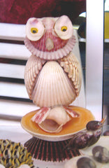 statues hibou coquillages