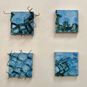 multiple squared, blue paintings